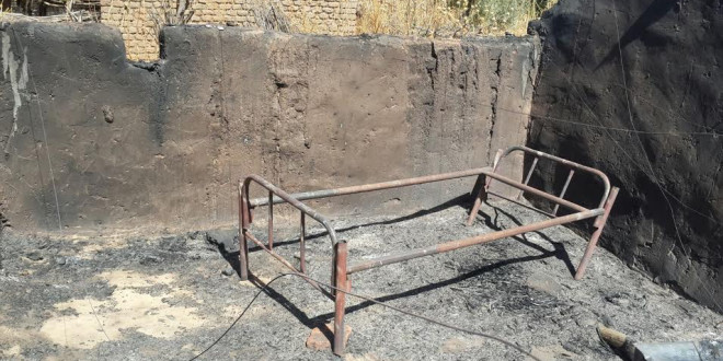 Burned home in Mouli village