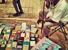 Man at the Mafroosh used book market. Photo: Khalid Albaih.